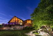 pic of ponds  - Modern house with koi pond under starry skies - JPG