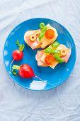 foto of smoked ham  - small sandwiches with smoked ham cheese and cherry tomato - JPG