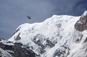 foto of rescue helicopter  - Rescue helicopter in Himalaya Mountains view from Annapurna Base Camp - JPG
