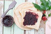 image of home-made bread  - breakfast : home made bread with mulberry jam on wooden table ** Note: Shallow depth of field - JPG