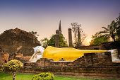 stock photo of gautama buddha  - old Temple Reclining Buddha Wat Yai Chai Mongkol at Ayutthaya Thailand World Heritage Site - JPG