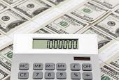 pic of million-dollar  - Calculator on one hundred american dollar bills - JPG