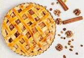 image of grease  - Uncooked homemade rustic apple pie preparation greased with egg yolk on white kitchen background - JPG