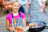 image of bbq food  - Family having barbecue food on grill at family garden BBQ  - JPG