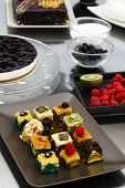 image of petition  - Assortment of delicious cakes and petit four pastries - JPG