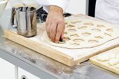 image of flour sifter  - Cutting forms in dough with cookie cutters - JPG