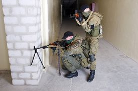 picture of ak-47  - insurgents with AK 47 ang RPD gun inside the building - JPG