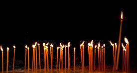 stock photo of prayer  - Group of religious candles burning in a orthodox christian church for prayers and wishes - JPG