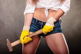 stock photo of gender  - Closeup of sexy oman holding hammer - JPG
