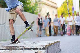 pic of skateboard  - Young skateboarder skateboarding on the street - JPG