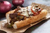 Philly cheese steak sandwich served on parchment paper poster