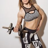 Постер, плакат: Perfect Fitness Body Of Beautiful Woman Fitness Instructor In Sports Clothing