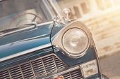 Detail Of A Vintage Car. Close Up Of Headlight Retro Classic Car. Vintage Effect Style Pictures. Cla poster