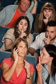 image of bleachers  - Loud woman on phone annoys people in theater - JPG