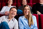 stock photo of movie theater  - Couple and other people - JPG