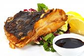 stock photo of flounder  - Fish flounder fried with vegetables and sauce - JPG