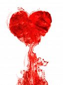 Heart shape ink of blood in water isolated