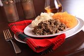 Scottish Haggis Table Setting For A Burns Night Dinner With A Royal Stuart Tartan Napkin