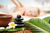 Spa Massage Under Tropical Palm. Beautiful Young Woman Getting Spa Massage. Focus On Spa Objects poster