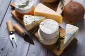 Cheese platter with blue, aged, yellow and white cheeses poster