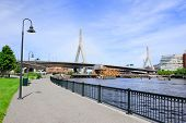 Boston Leonard P. Zakim Bunker Hill Memorial Bridge with blue sky as the famous land mark over Charl