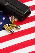 Gun And Bullets On Flag