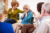 Unhappy Woman Attending Self Help Therapy Group Meeting In Community Center poster