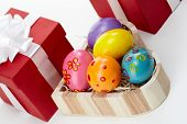 Tilt up of an Easter still-life with painted eggs and giftboxes