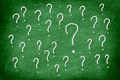 Questions. Question mark on green chalkboard / blackboard.