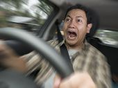 Portrait Of Male Asian Driver Shocked And Panic About To Have Crash Accident, Zoomed Motion Blur Def poster