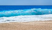 Close Up Photo Of Beautiful Sea Wave Splash With Foam On A Sandy Beach. Summer Vibes. Vacation Holid poster