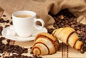 Coffee cup with croissants