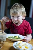 Young Child Eating Spinach