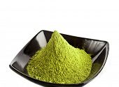 powdered green tea over a white