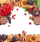 christmas card of cookies , berries , fruits , different xmas ingredients and spices on a white back