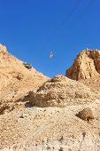 foto of masada  - Cableway cabin descends from the fortress Masada - JPG