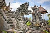 stock photo of dua  - Dragon monster secure the entrance of Pura Padmasana Puja Mandala Temple - JPG