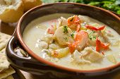 stock photo of halibut  - A bowl of creamy seafood chowder with lobster - JPG