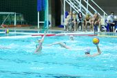 MOSCOW - MARCH 3: Men play water polo in pool, spectators, judge watch match at 7th round match of R