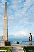 stock photo of darjeeling  - Gurkha soldier statue at Batista Loop on the way of Toy Train in Darjeeling India - JPG