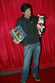 UNIVERSAL CITY - DEC. 4: Lorenzo Lamas & his dog Blueberry arrive at Mike Arnoldi's birthday celebra