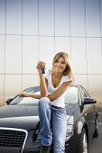 picture of car key  - Young woman holding keys to new car - JPG