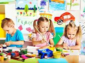 image of schoolgirls  - Child painting at easel in school - JPG