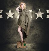 picture of army cadets  - Vintage portrait of a beautiful young army pinup woman posing in military fashion with provocative style camouflage heels and a military jacket on grunge star background - JPG
