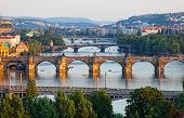 stock photo of bohemia  - View of the Vltava River and the bridges shined with the sunset sun Prague the Czech Republic - JPG