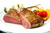 Delicious Beef Steaks On White Dish With Grilled Vegetables