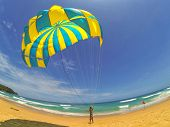 PHUKET THAILAND AUGUST 6: Unidentified man prepares a parachute for tourists on the beach, on August