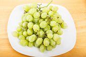 White Seedless Grapes On White Plate