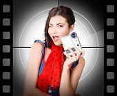 Beautiful Woman Holding Home Video Camera