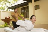 pic of thai massage  - Woman getting Thai massage from professional masseuse - JPG